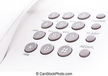 phone keypad - close up shot of grey and white phone keypad...