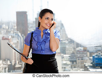 Young Female Executive on Call - Young female executive...