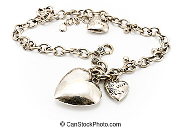 Silver necklace with heart pendants isolated on white