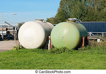 storage tanks - white and green storage tanks