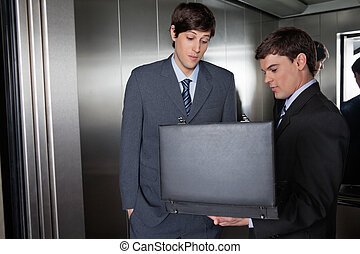 Business Men with Briefcase in Elevator