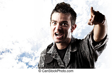soldier pointing with finger - portrait of young soldier...
