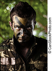 young solider - portrait of young soldier face against a...