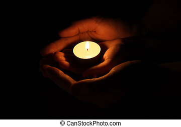 Candle in hand. The concept of protection