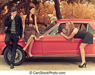 60s or 50s style image young people with car