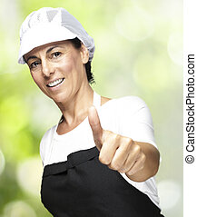 middle aged woman - portrait of middle aged woman with apron...