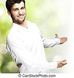 man welcome gesture - portrait of a handsome young man...