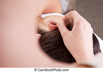 Ear Acupuncture Treatment - Detail view of professional...