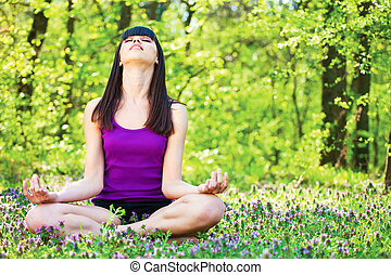 yoga relaxation in forest - Young woman in lotus pose at the...