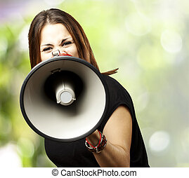 woman with megaphone - portrait of young woman shouting with...
