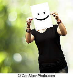 woman with smile emoticon - Woman showing a blank paper with...