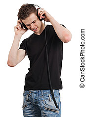 Young male listening to headphones - Photo of an attractive...