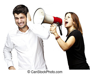 woman shouting with megaphone - young woman screaming a man...