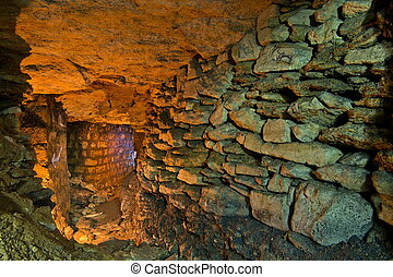 The wall in catacombs - The stone wall in the underground...