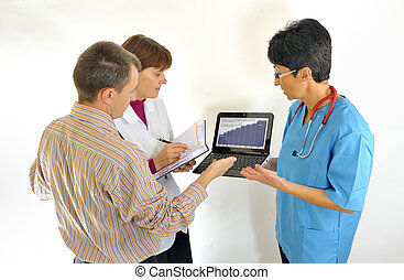 doctor using computer and reviewing medical reports