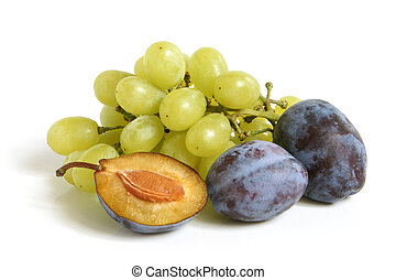 Bunch of grapes and plums on a white background