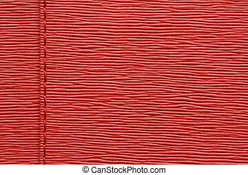 Natural red leather background closeup
