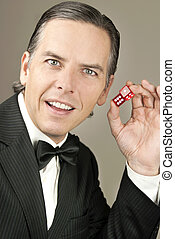 Confient Gentleman In Tux Holding Dice, Side - Close-up of a...