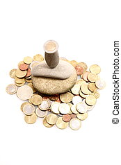 Financial Balance - Coins and Pepples on white background as...