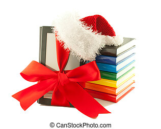 Electronic book reader wearing Santa's hat with stack of...