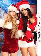 merry xmas - Two beautiful young women in Christmas clothes...