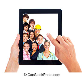 Tablet computer and group of business people. - Hands with...