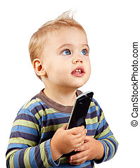 Baby boy with remote - Studio portrait of a happy one year...