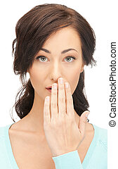 woman with hand over mouth - bright closeup picture of woman...