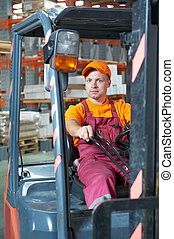 warehouse worker driver in forklift - young cheerful...