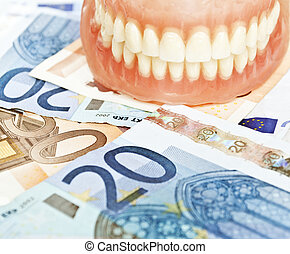 Denture on euros - dental expenses concept
