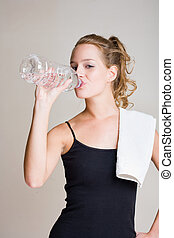 Hydrate - Portrait of gorgeous young woman drinking after...