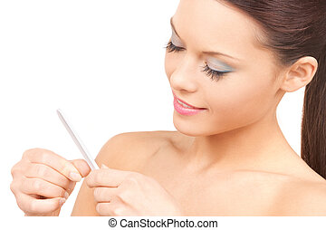 beautiful woman polishing her nails - picture of beautiful...