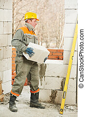 bricklayer at construction masonry works