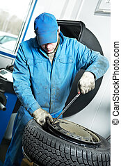 machanic repairman at tyre fitting - mechanic repairman...
