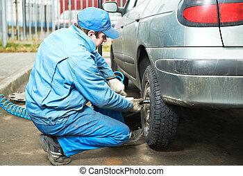 machanic repairman at tyre fitting