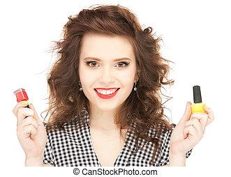 beautiful woman polishing her nails