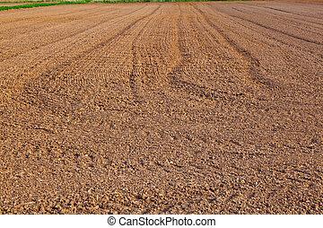 mark of tire on field - mark of tire on freshly plowed field...