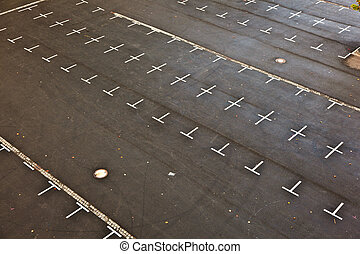 marked parking lot without cars with crosses
