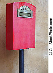 Postal Box - Red Italian Postal Box against Yellow Brick...