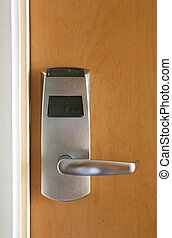 Keycard Door - Keycard electronic lock on closed wooden door...
