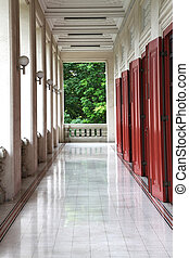 Corridor of Thai Style building to green tree