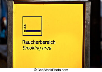 sign smoking area in a station