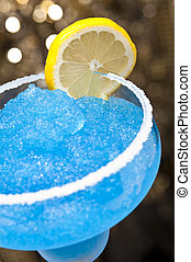 Blue margarita Cocktail in front of different colored...