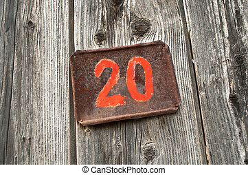Number 20 - Number twenty on metal plate attached to wooden...