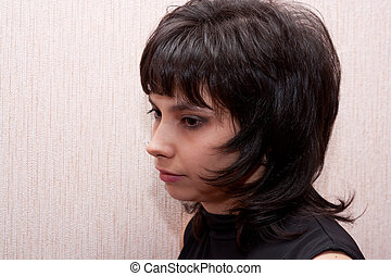 Closeup portrait of thoughtful young brunette girl.