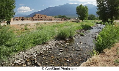 Red Willow Creek and Taos Pueblo - The Red Willow Creek, or...