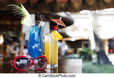 alcoholic cocktails and sunglasses in the beach cafe