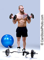 Young, masculine and fit man lifting weights - Young, strong...