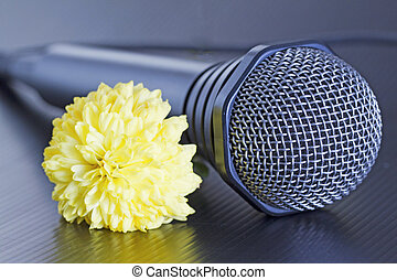 Microphone and flower - Gray microphone with yellow flower...