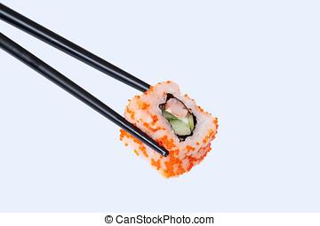 sushi on chopstick. Traditional Japanese food Sushi. Grey...